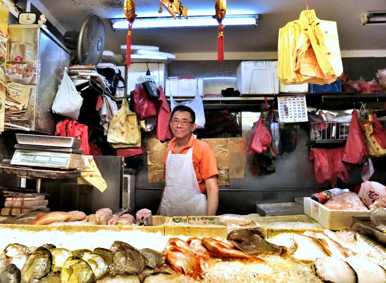 Samuel the fishmonger at Bishan market in Singapore