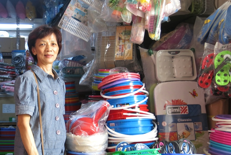Shop selling brooms, buckets, and other cleaning supplies at Eunos Circle in Singapore - Shopkeeper Stories