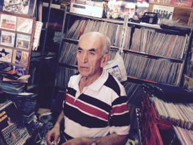 Music Shopkeeper in Bogota Colombia selling CDs, acetates, and records | Shopkeeper Stories