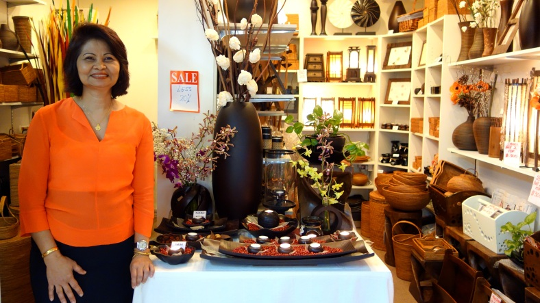 Mango Wood Crafts with home decoration such as handcrafted frames, basklets, and vases at Holland Village in Singapore | Shopkeeper Stories