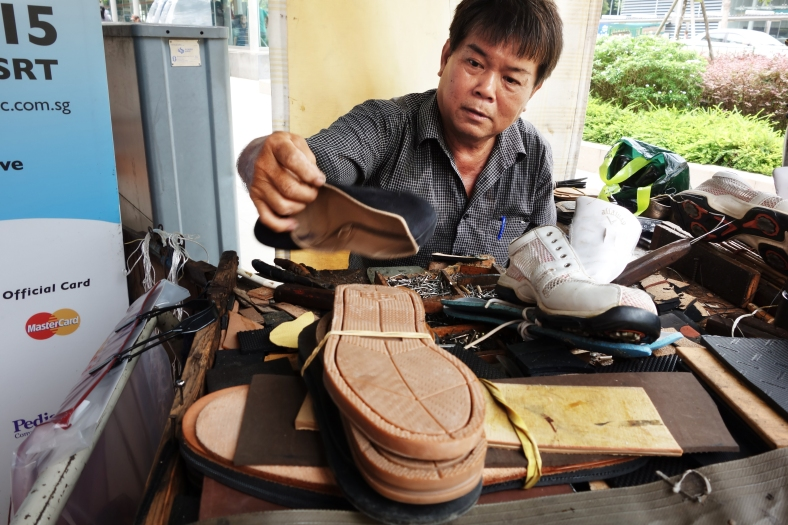 Mr Chia, a cobbler at Holland Village in Singapore, repairing shoes | ShopkeeperStories.com