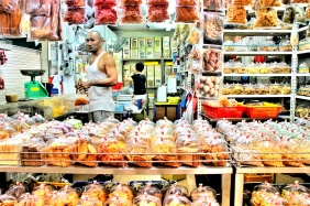 Junk food at the market in Singapore selling biscuits, dried fruits, and other snacks | Shopkeeper Stories