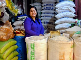 Selling rice at a market stall in Cambodia - Shopkeeper Stories