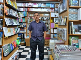Basheer Graphic Books with the owner Abdul Nasser at Bras Basah Shopping Complex in Singapore - a bookshop series by Shopkeeper Stories | ShopkeeperStories.com