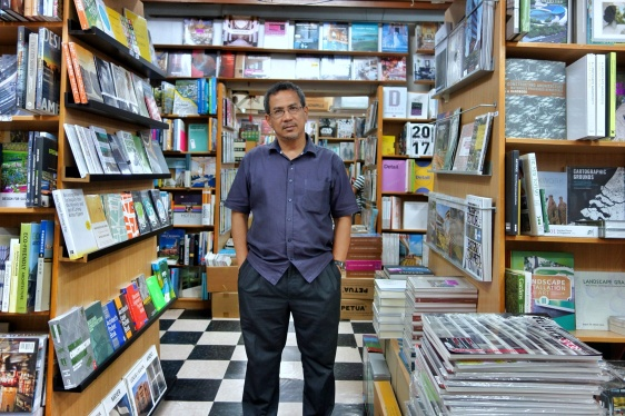 Basheer Graphic Books with the owner Abdul Nasser at Bras Basah Shopping Complex in Singapore - a bookshop series by Shopkeeper Stories   ShopkeeperStories.com