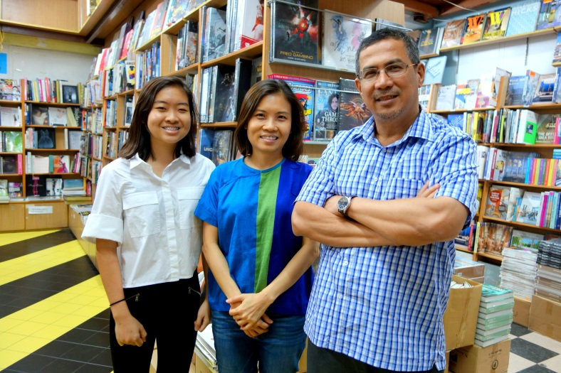 Basheer Graphic Books with the owner Abdul Nasser and his customer Dawn Liang at Bras Basah Shopping Complex in Singapore - a bookshop series by Shopkeeper Stories